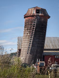 Old Ruined Farm Silo in Vermont. An unused dilapidated farm silo made of wood tilting precariously Royalty Free Stock Image