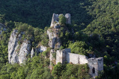 Old ruined fortress on mountain Stock Photo