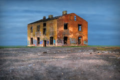 Old ruined house. Old abandoned house in the middle of the field Stock Image