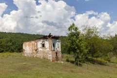 Old ruined house. In the mountains Stock Image