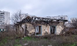 Old ruined house. On the outskirts of the city. Abandoned old building. Poverty, old age and financial crisis Stock Images