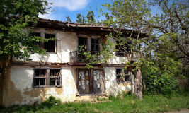Old ruined house in spring. Old ruined village house during spring Stock Photo