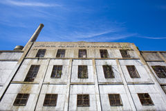 Old ruined industrial factory with blue sky in Uruguay Stock Photos