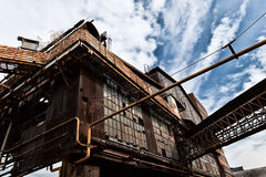 An old ruined metallurgical firm's exterior facade Stock Photo