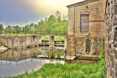 Old ruined mill on the river Royalty Free Stock Images