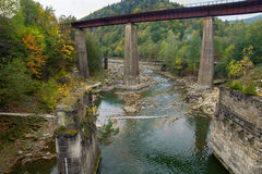 Old ruined railroad bridge crossing the river Royalty Free Stock Images