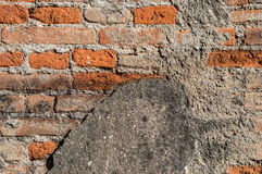 Old ruined red brick wall with cement Royalty Free Stock Photos