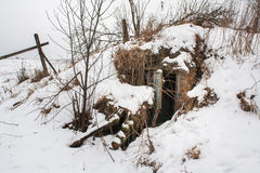 Old ruined shelter covered a snow Royalty Free Stock Photo