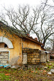 Old ruined stone barn with walled up Windows Royalty Free Stock Photos