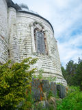 Old ruined stone church on the edge of the forest. Old ruined stone church in the forest Stock Images