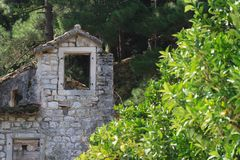 Old ruined stone house in Europe. Royalty Free Stock Images