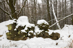 Old ruined stone wall under snow Stock Photography