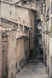 Old ruined street on brick wall homes Stock Images