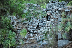 Old ruined wall with masonry. God of Mountain castle in Olympus, Antalya stock image