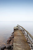 Old ruined wooden pier on Saimaa lake Royalty Free Stock Photos