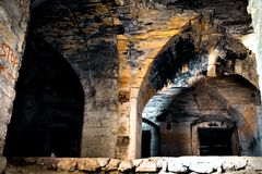 Old ruins of an abandoned castle. Basement of an old abandoned castle in ruins Stock Photography