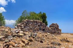 Old ruins of ancient wall in Chora Sfakion town on Crete island, Greece Royalty Free Stock Photos