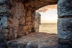 Free Old Ruins Background With Scenic Sunset Over Sea Through Ancient Castle Window With Dramatic Sky And Perspective View With Effect Stock Photography - 99318272