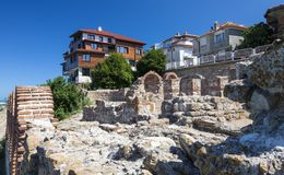 Residential houses and excavations of a church in the old town of Nessebar. Royalty Free Stock Photos