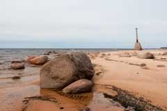 Old ruins of lighthouse on the shore of Baltic sea. In Kurmrags, Latvia Stock Photo