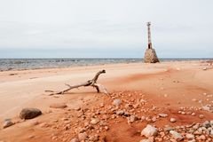 Old ruins of lighthouse on the shore of Baltic sea. In Kurmrags, Latvia Stock Image
