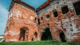 Old ruins of a medieval abandoned ruined red brick castle or Orthodox temple. Vintage toned Royalty Free Stock Photography