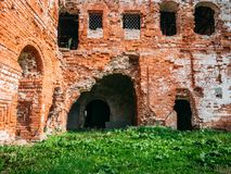 Old ruins of a medieval abandoned ruined red brick castle or Orthodox temple. Vintage toned Stock Photos