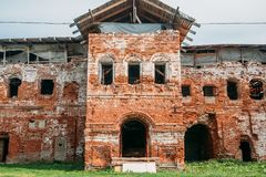 Old ruins of a medieval abandoned ruined red brick castle or Orthodox temple. Vintage toned Royalty Free Stock Photos