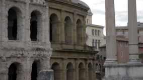 Old ruins in Rome, Italy. Close shot of damaged or unfinished wall with arcades somewhere in Rome, Italy stock footage