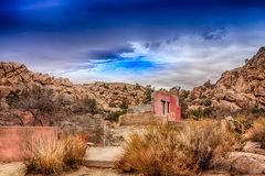 Old Ruins Under a Dark Sky. Old Ruins surrounded by desert and dark skies at Joshua Tree stock images
