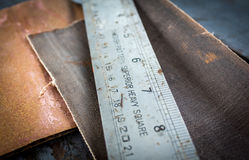 Old ruler and sandpaper Royalty Free Stock Images