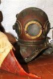 Old, rumpled diving helmet Stock Images