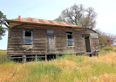 Old run down country wooden house royalty free stock images