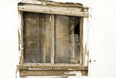 Old run down exterior window in desperate need of repair Stock Photography