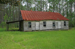 Old run down schoolhouse. In the woods Stock Image