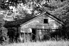 An old run down shack. An old house that is falling in Royalty Free Stock Image