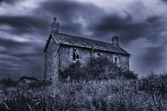 Old run-down spooky haunted house with stormy skies Stock Photography
