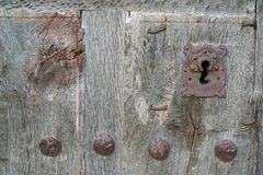 Old run-down wooden door and iron lock Stock Photos