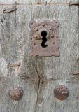 Old run-down wooden door and iron lock Royalty Free Stock Photo