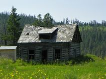 Old rundown log farm house in the wilderness Royalty Free Stock Image