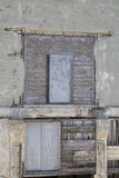 An old rundown warehouse wall with two wood doors Royalty Free Stock Images