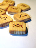 Old runes. Wooden runes on the white background Royalty Free Stock Photo