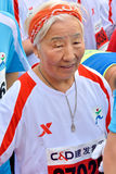 Old runner in International marathon in Xiamen, China, 2014 Stock Photography