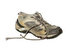 Old running shoe. Old dirty running shoe isolated over white Royalty Free Stock Photos