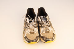 Old running shoes. A pair of old running shoes on a white background Stock Photography