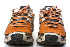 Old running shoes. Photo of old running shoes on white background stock image