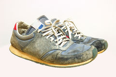 Old running shoes isolate on a white background Stock Photos
