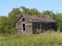 Old rural abandoned wooden collapsing house. Royalty Free Stock Images