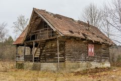 Old rural abandoned wooden collapsing house Stock Images