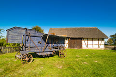 Old rural barn in Poland and threshing-machine- XIXth century Royalty Free Stock Image